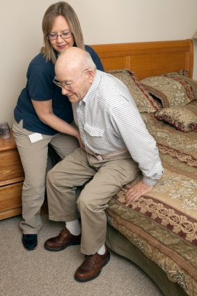 Caregiver Helping Senior Man