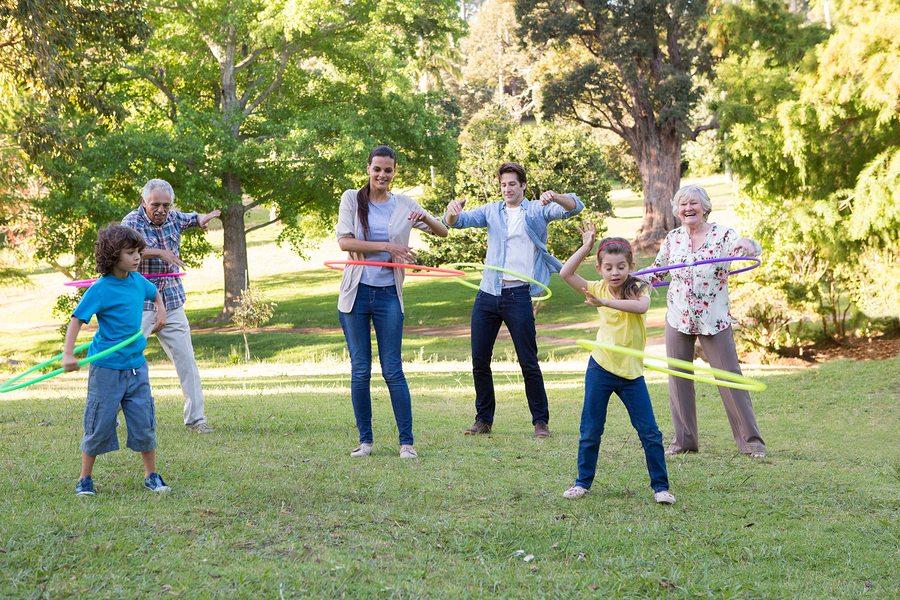 Outdoor play asian family stock photos