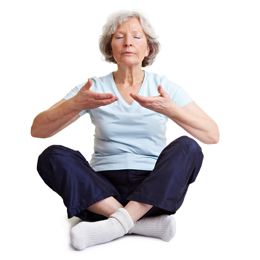 Caregivers in West Memorial TX: Old senior woman meditating and relaxing with breathing exercises